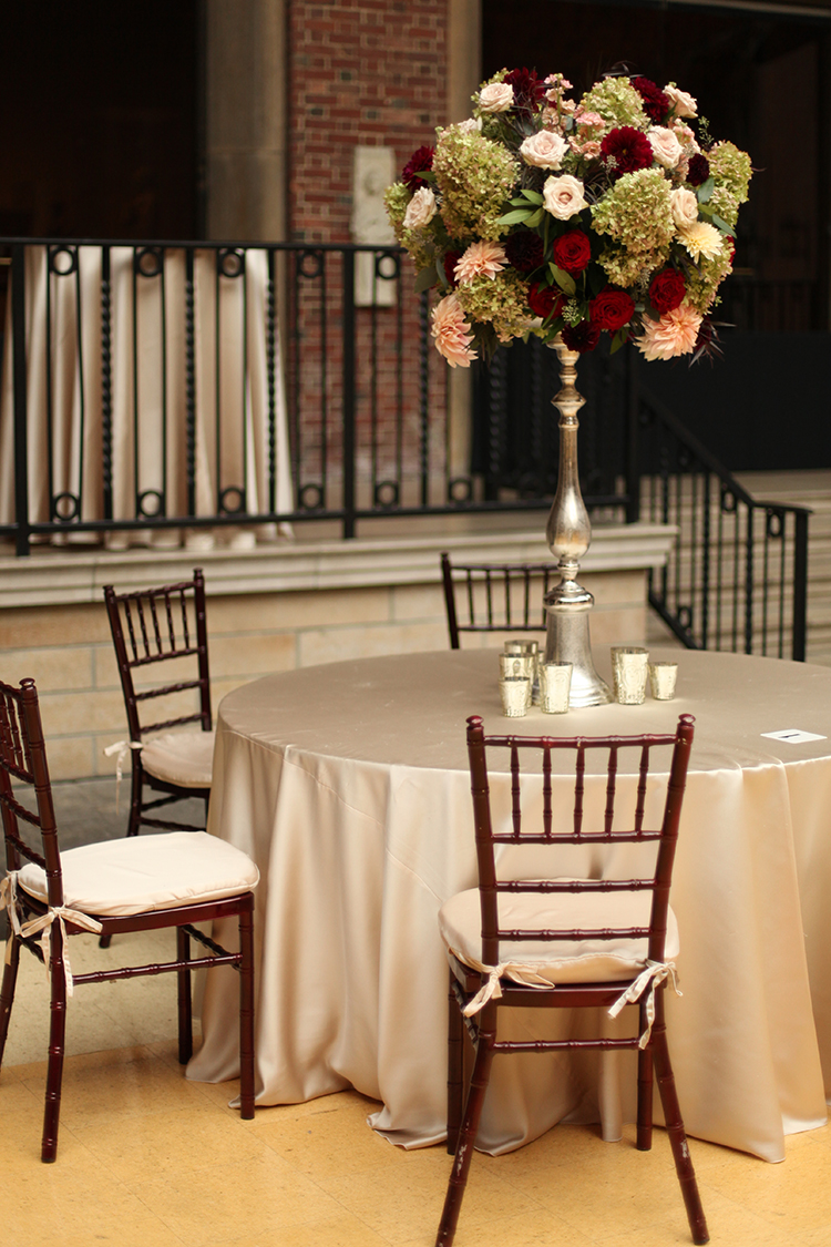 Tall burgundy and blush centerpiece at The Dayton Art Institute, by Cincinnati wedding florist Floral Verde.