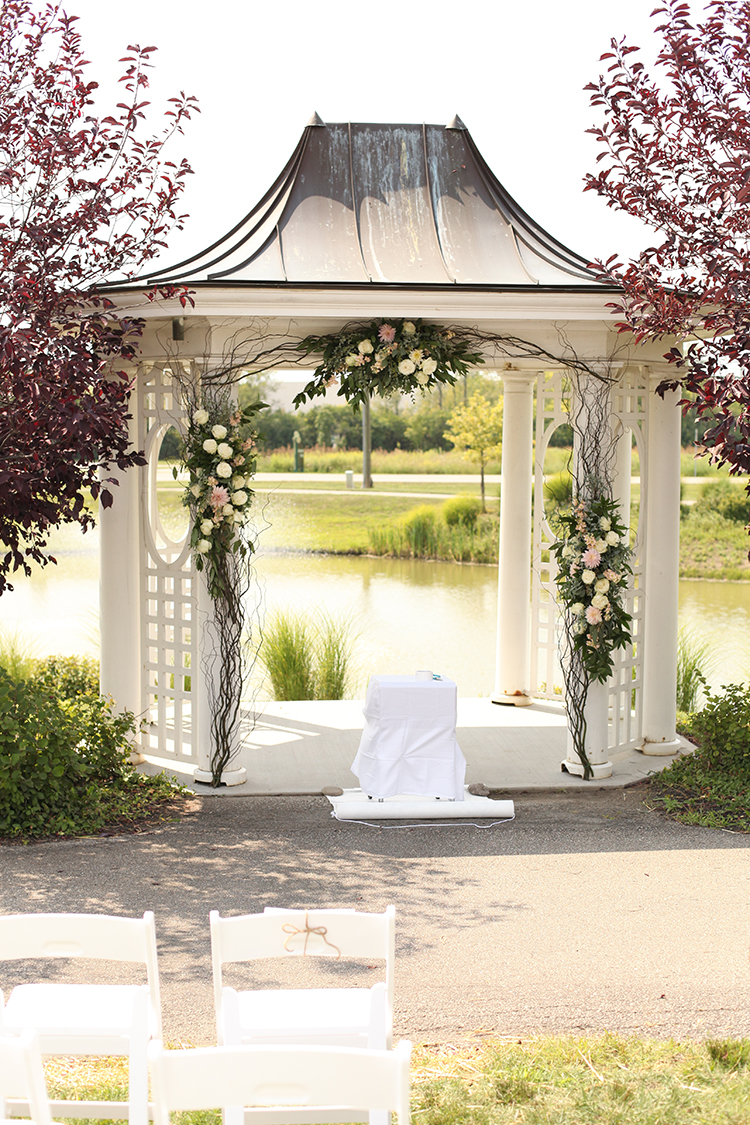 Wedding ceremony gazebo at Mulhauser Barn. Flowers by Cincinnati wedding florist Floral Verde.