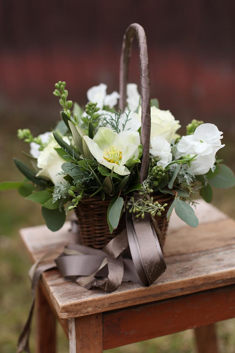 Flower girl basket with cascading ribbons by Cincinnati wedding florist Floral Verde.