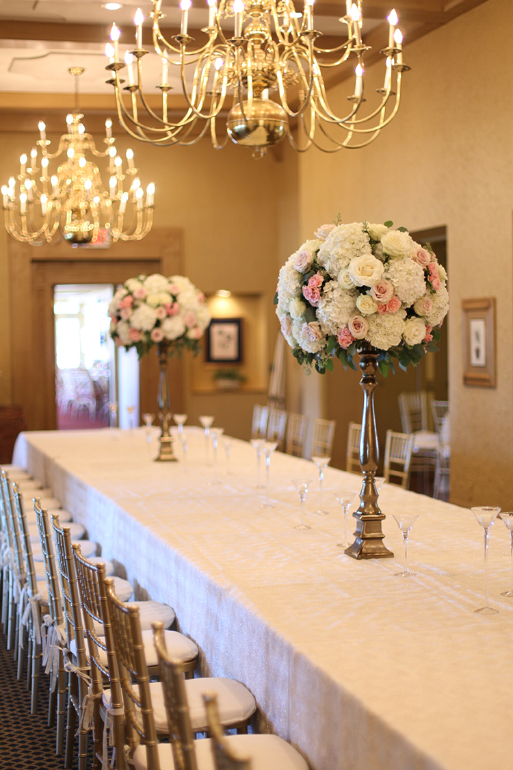 Tall white and blush centerpiece at Kenwood Country Club, by Cincinnati wedding florist Floral Verde.
