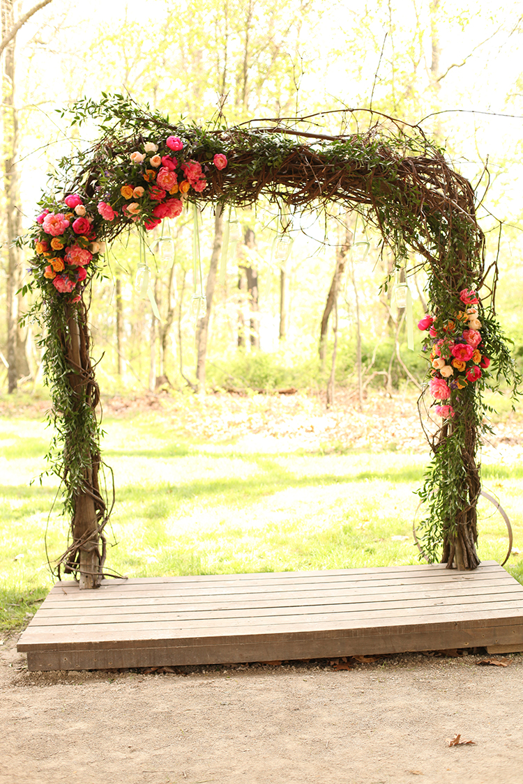 Wedding ceremony arch at The Mohicans. Flowers by Cincinnati wedding florist Floral Verde.