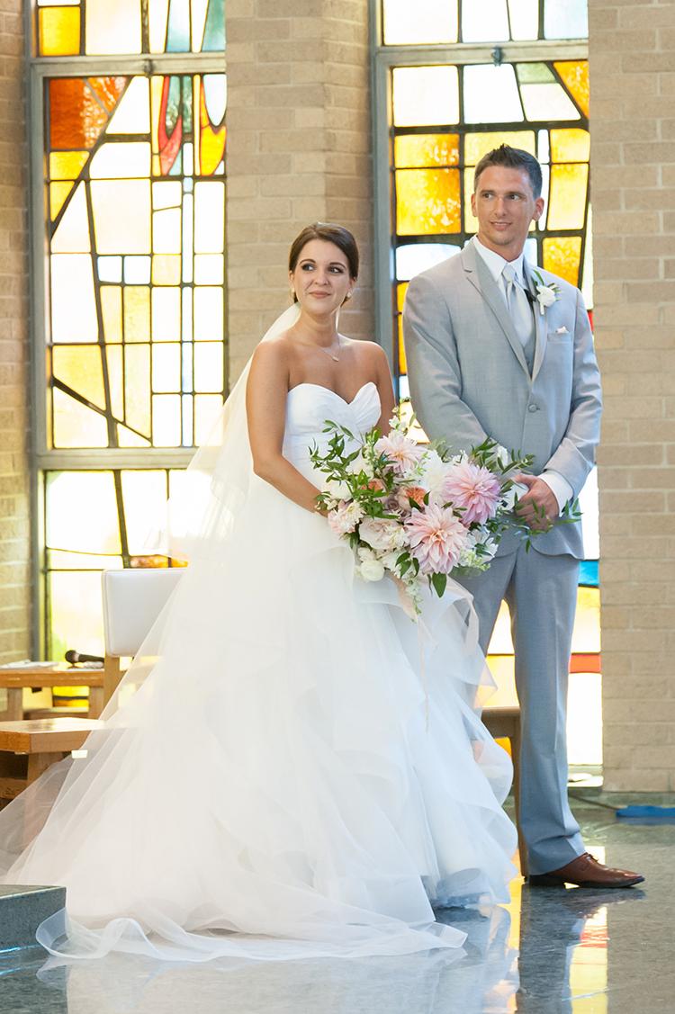 Wedding Ceremony at Mount Saint Joseph University Mater Dei Chapel in Cincinnati, Ohio. Flowers by Floral Verde. Photo by Ben Elsass Photography.