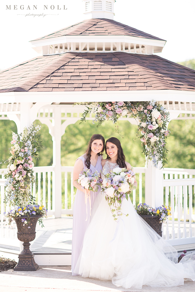 Wedding ceremony under the gazebo at Aston Oaks in North Bend, Ohio. Image by Megan Noll Photography. Flowers by Floral Verde.
