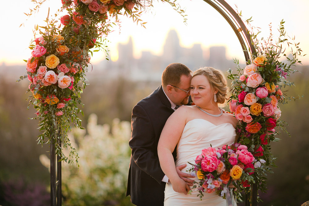 Wedding ceremony at Weidemann Hill Mansion in Newport, Kentucky. Image by Jonathan Gibson Photography. Flowers and rental arch by Floral Verde.