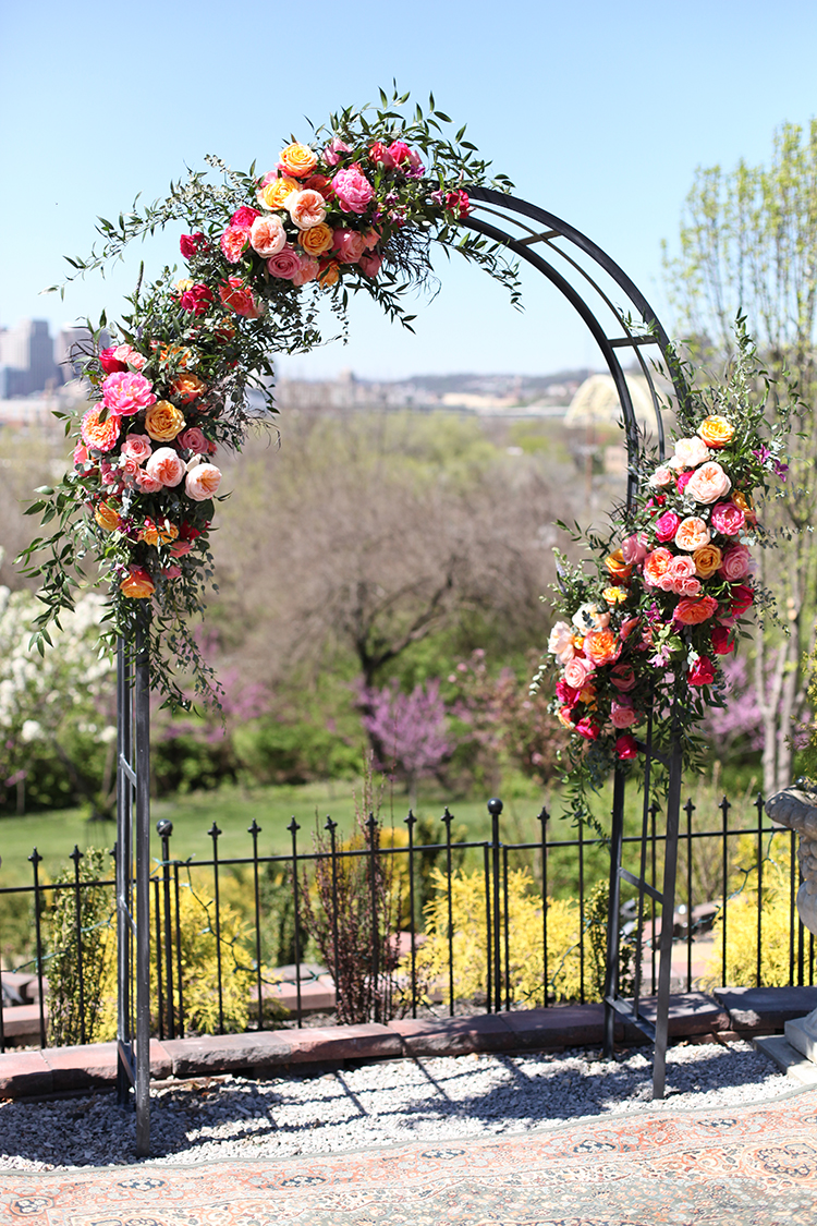 Wedding ceremony at Weidemann Hill Mansion in Newport, Kentucky. Flowers and rental arch by Floral Verde.