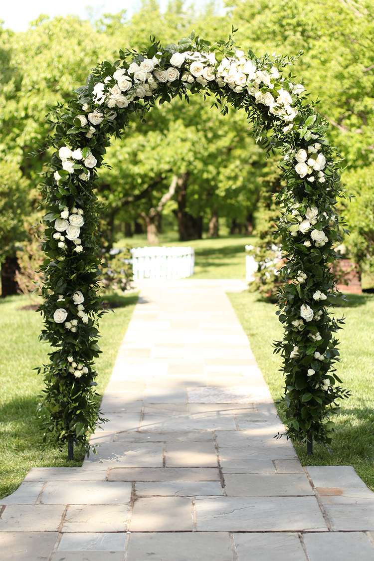 Wedding ceremony at Pinecroft Mansion in Cincinnati, Ohio. Flowers and rental arch by Floral Verde.