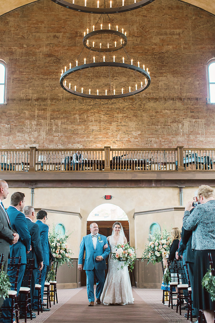 Wedding ceremony at the Monastery Event Center in Cincinnati, Ohio. Image by Amanda Donaho Photography. Flowers and rental trees by Floral Verde.