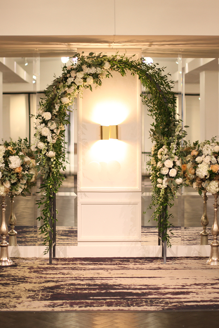 Wedding ceremony at Hotel Covington in Covington, Kentucky. Flowers and rental arch by Floral Verde.