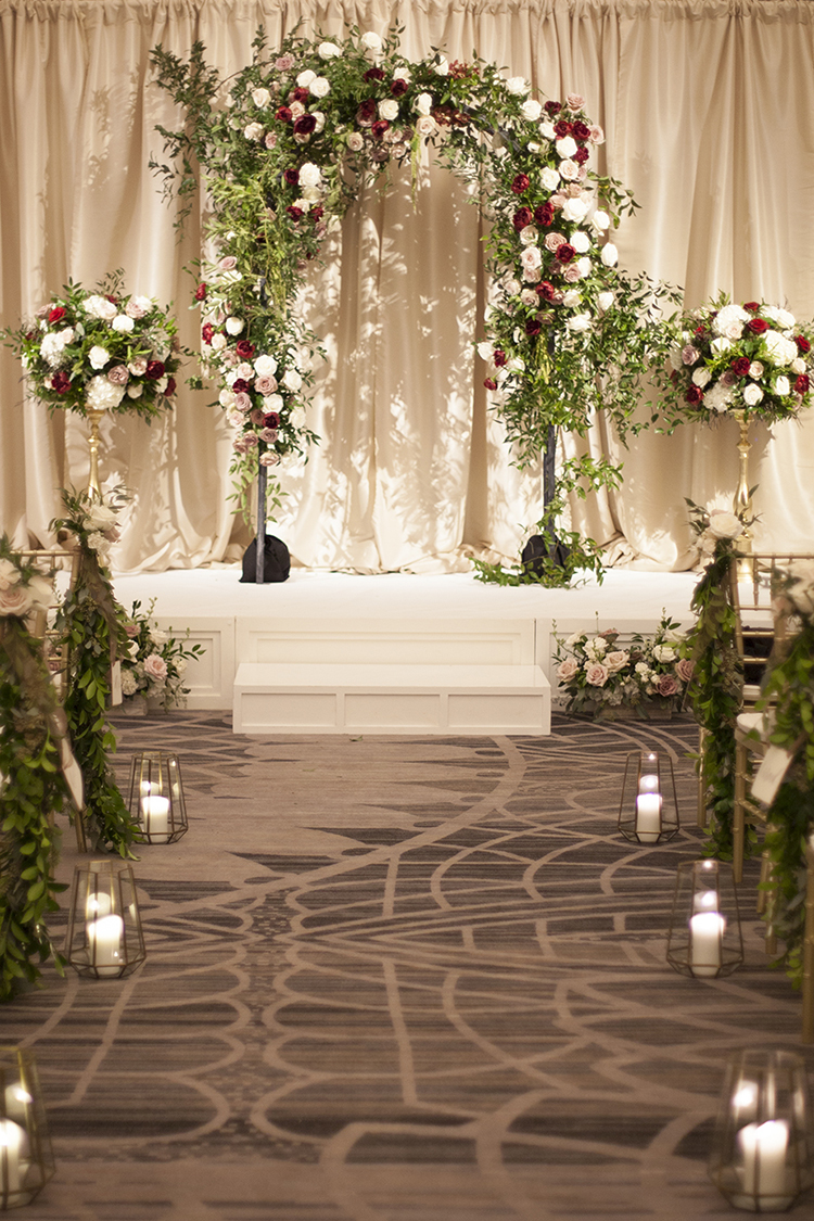 Wedding ceremony at The Renaissance in Cincinnati, Ohio. Flowers and rental arch by Floral Verde.