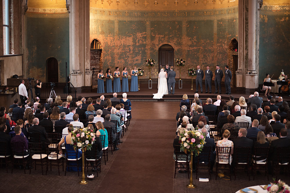 Wedding at The Monastery Event Center in Cincinnati, Ohio. Flowers by Floral Verde. Photo by Parisi Images.