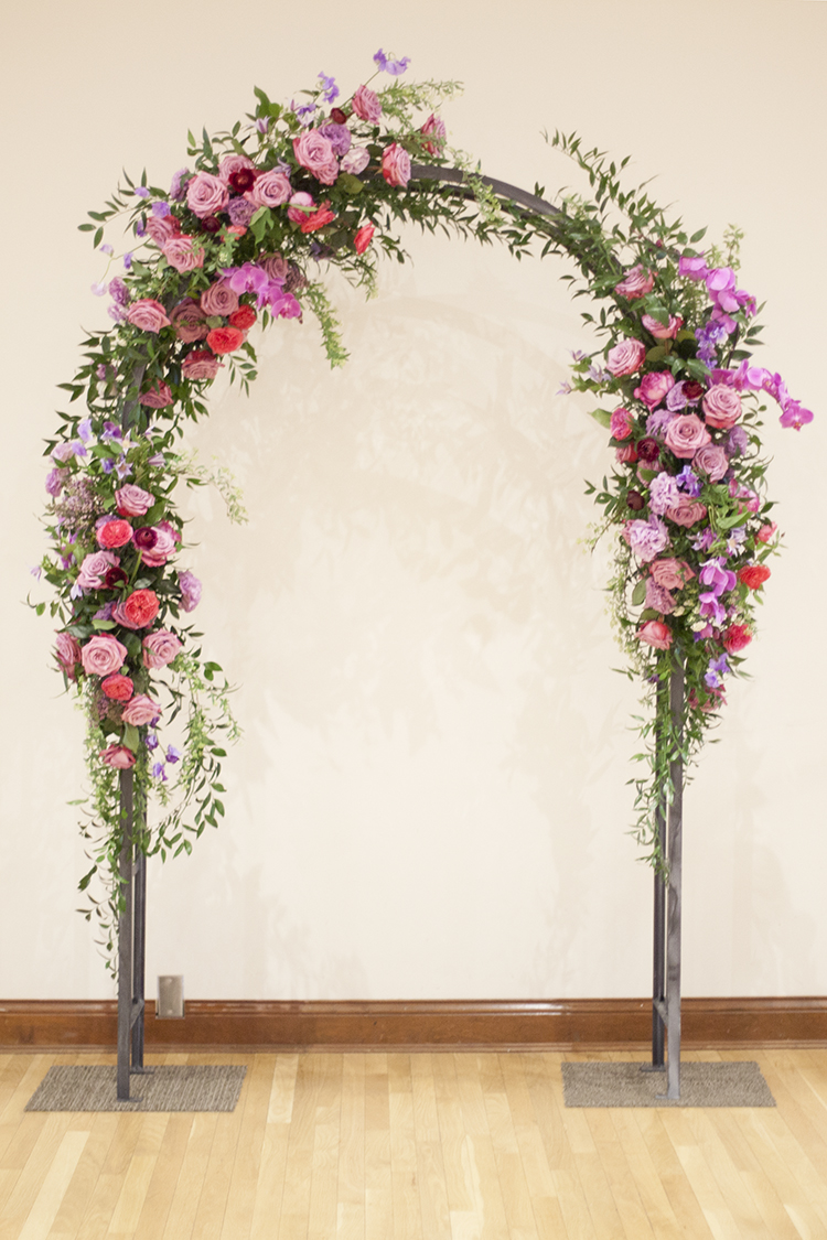 Wedding ceremony at The Center in Cincinnati, Ohio. Flowers and rental arch by Floral Verde.
