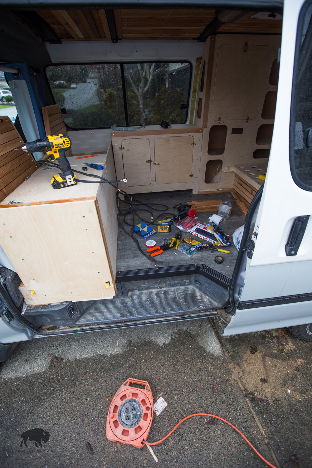 And so begins the wiring phase of the build and then a tool and wire explosion went off in the van.  You'll also notice that face on the kitchen, that whole thing pulls out to reveal our cooking area...which oddly enough I totally forgot to photograph.