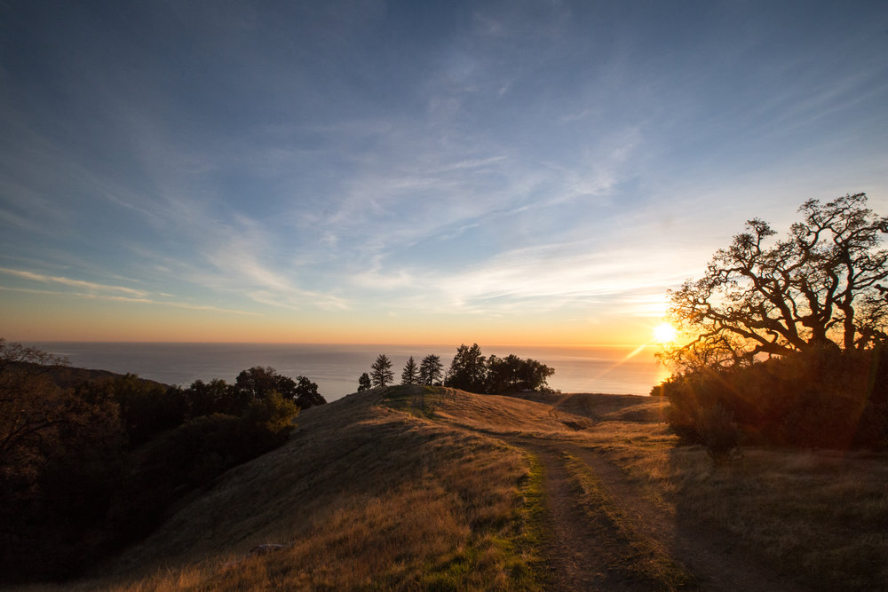 Peaceful sunsets from atop a mountain ridge overlooking the Pacific Ocean.