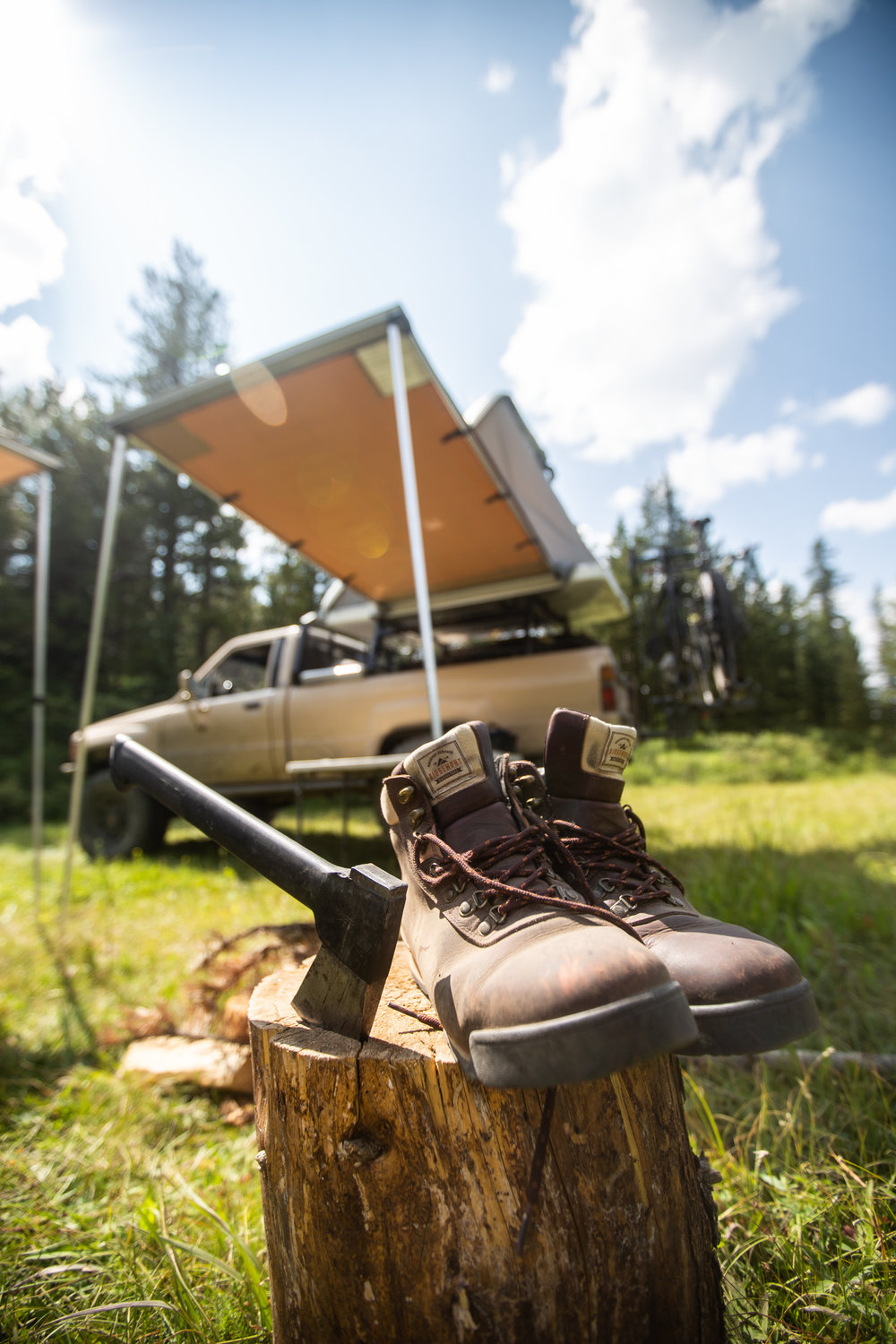 In the spirit of camping, boots, hatchet, trucks and tents.