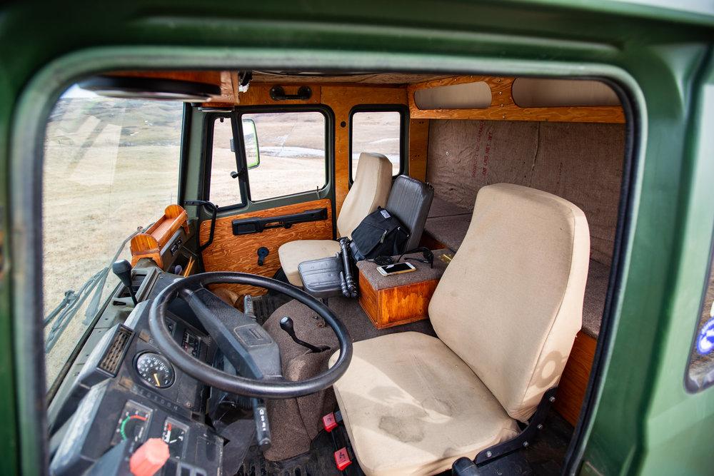 Note the drivers arm rest/ storage unit.