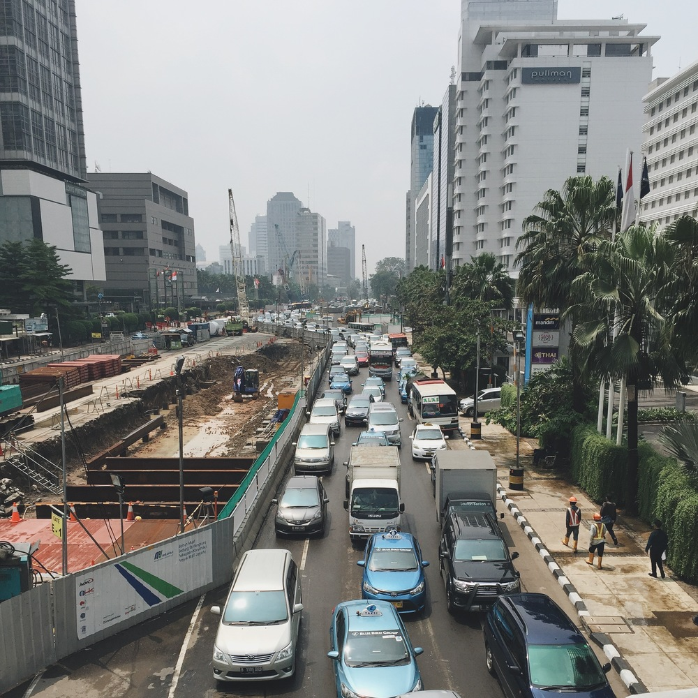 Traffic in Jakarta at a standstill next to a construction site for the new train system that will go above and below ground and will be the first mass-transit available in Jakarta, besides some busses and a regional train.