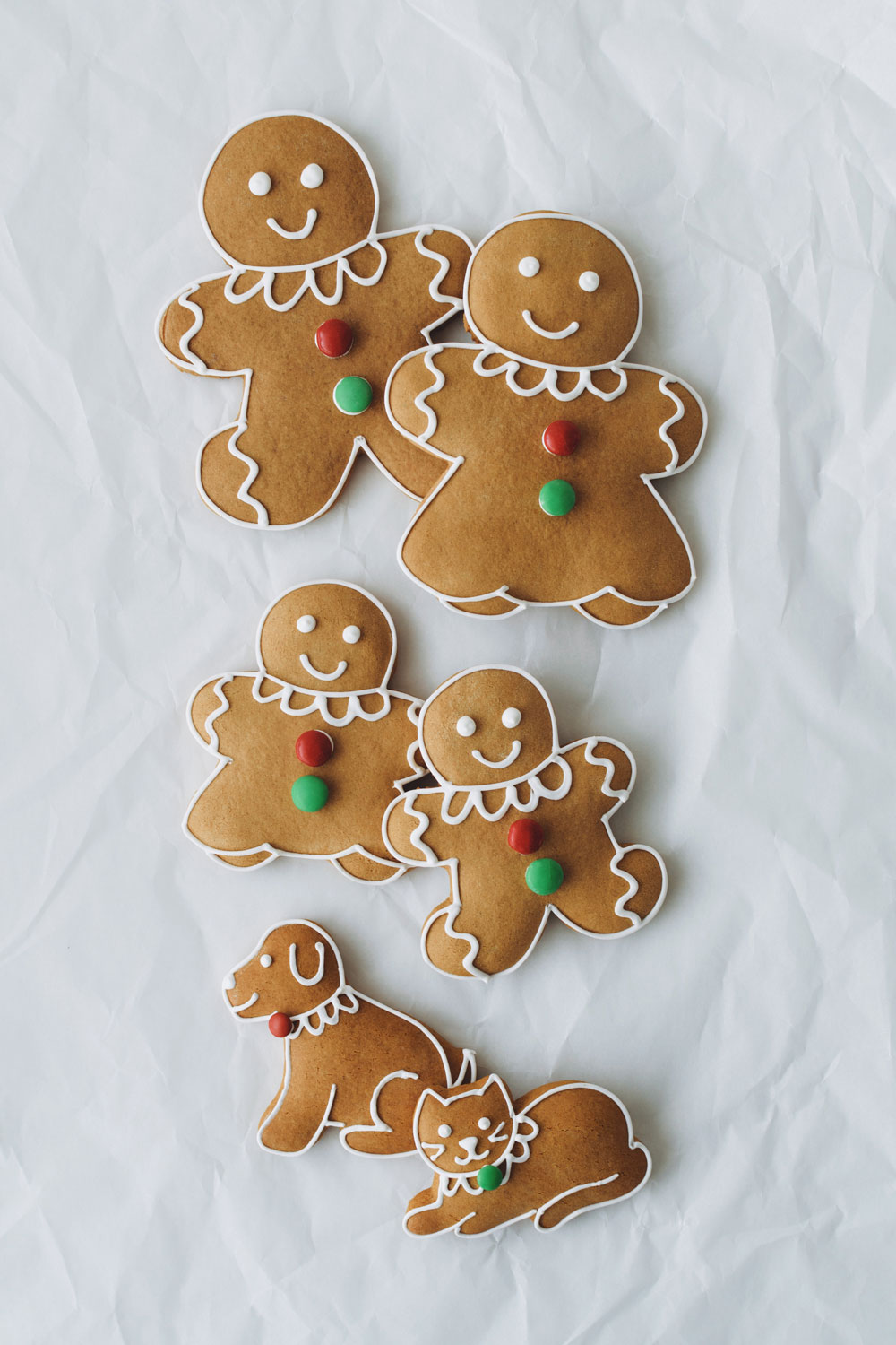 GINGERBREAD PEOPLE + PETS - classic gingerbread cookies decorated with firm royal icing and M&M'slarge $4.25 / medium + pets $3.25