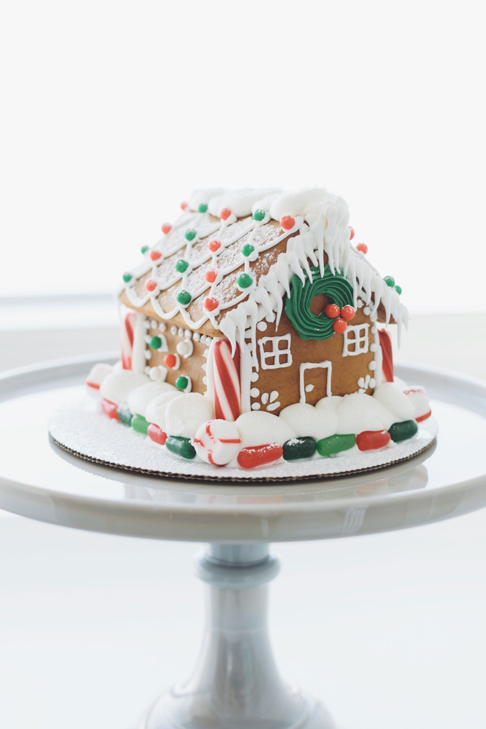 CANDY GINGERBREAD HOUSE - classic gingerbread decorated with icing, candy, and powdered sugarsmall (shown) $45 / medium $65