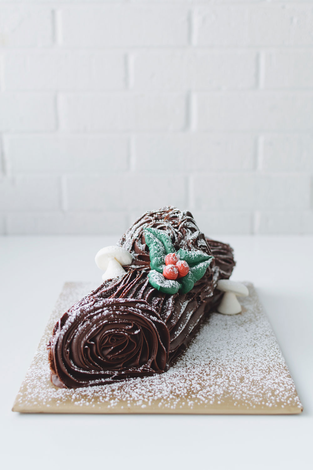 YULE LOG - chocolate cake rolled with chocolate mousse, iced with chocolate fudge icing, and dusted with powdered sugar$46
