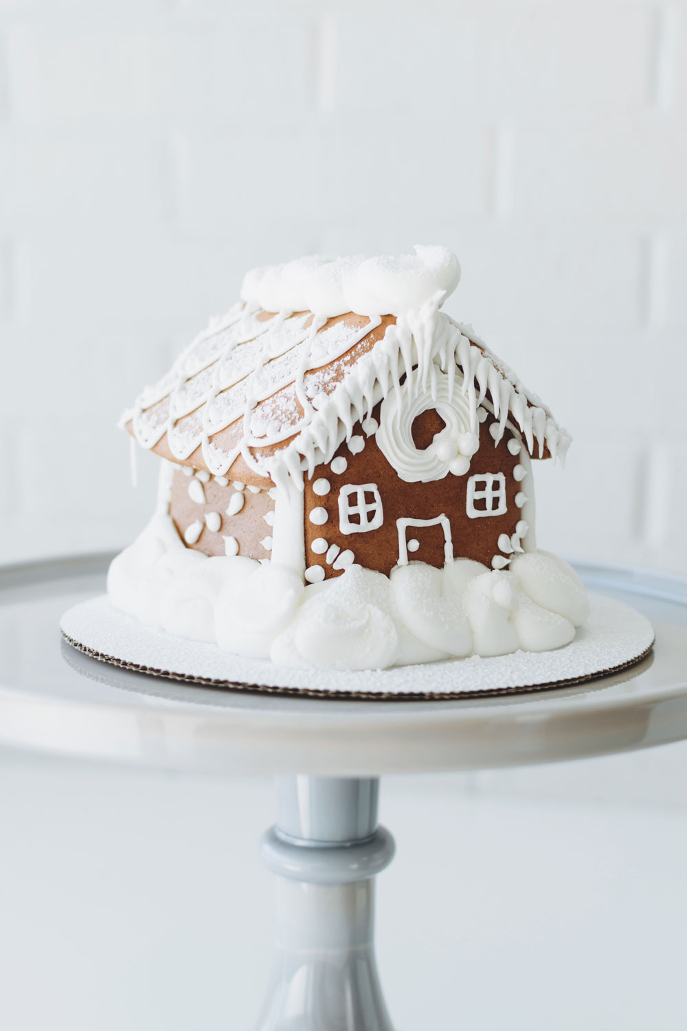 SNOW-CAPPED GINGERBREAD HOUSE - classic gingerbread decorated with icing and powdered sugarsmall 3.5