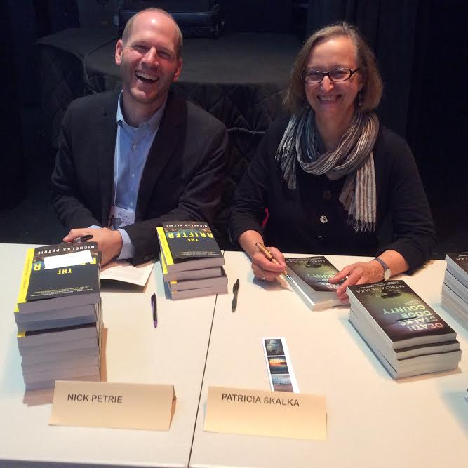 Signing books at the 2016 Washington Island Literary Festival, with author Nicholas Petrie.