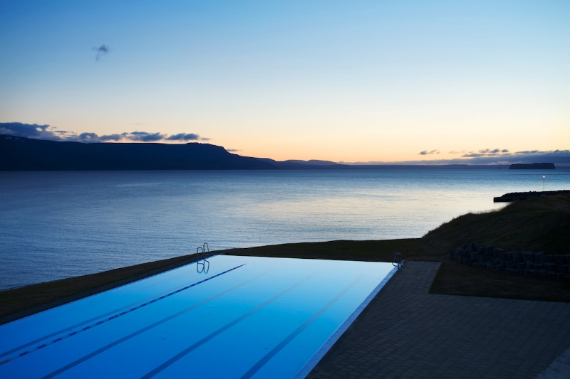 In Hofsós, a sleek and modern pool sits perched at the edge of the earth with an infinity edge all around. Built into the edge of the cliffs of Skagafjörður, the minimalist architecture ensures that nothing comes between you and the serenity of overlooking your own personal slice of the Arctic.