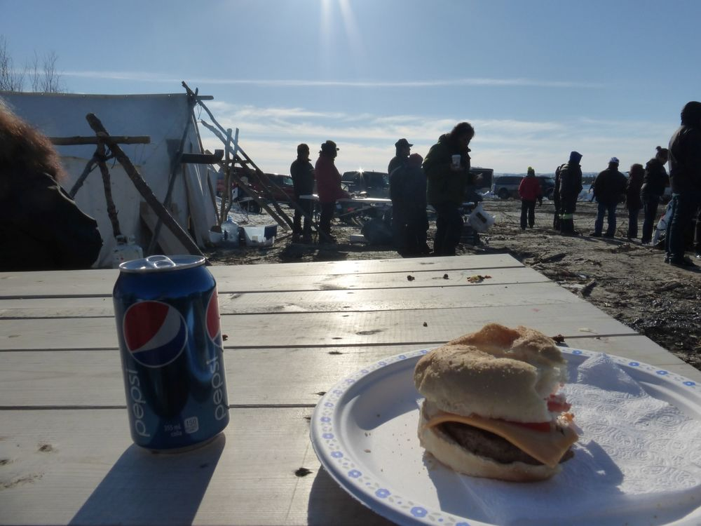 Eating some local 'junk food' from one of the tents. There ain't no McDonalds here.