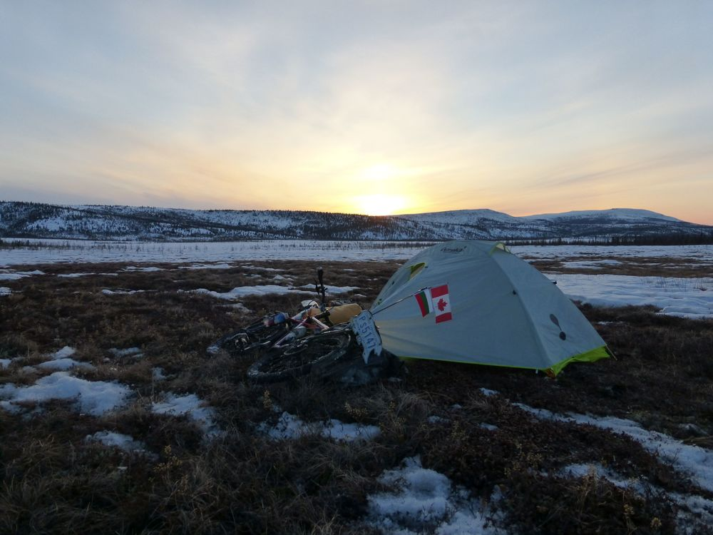 I spot a patch of tundra not covered in snow beside the road. It's a good place to camp.