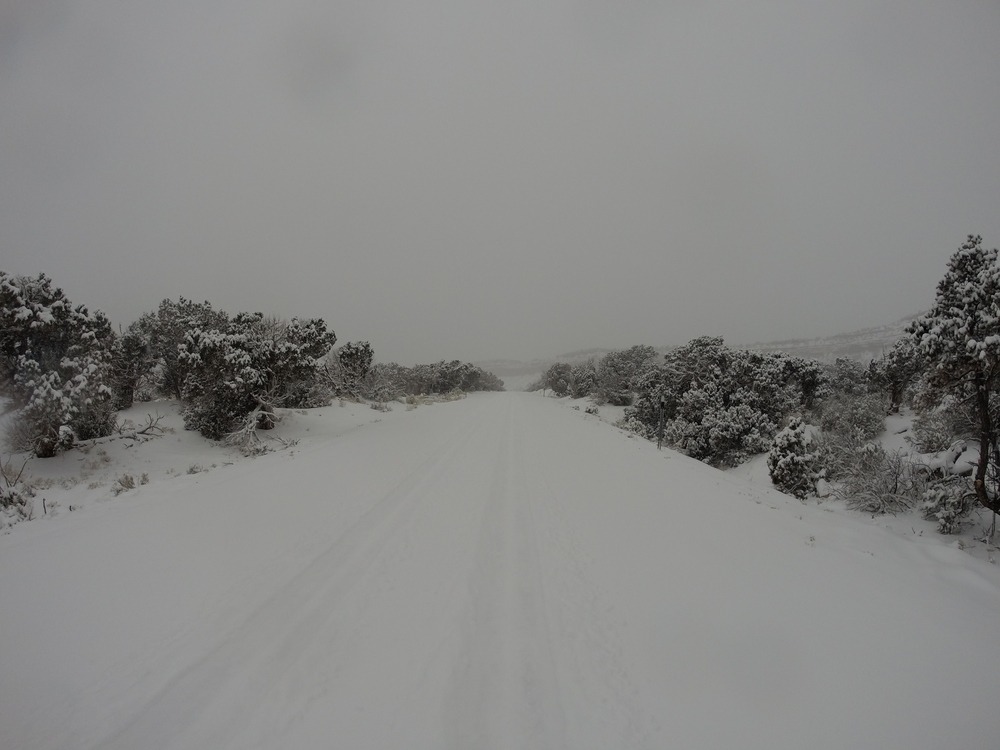 Deep snow, two sets of tires led my way to The Natural Bridges Monument