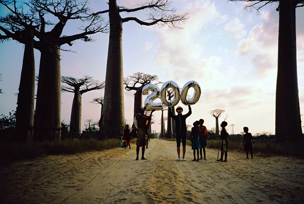 I got the 200th one in Madagascar. Comparing with the 100th film, I scaled up the size of the figure and prepared balloons which was effectively shown with the dazzle of the African sun.