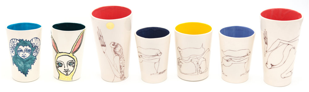 Image transfer cups from line drawings. Some have 24kt gold glaze details.