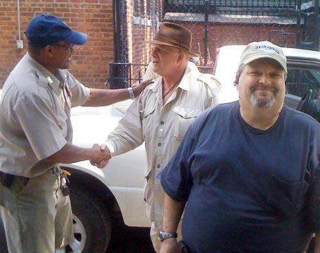 Tompkins Square's new manager Duval Drumond (left) shakes hands with District Manager Mike McLean (center), and retiring manager Harry Greenberg (right)