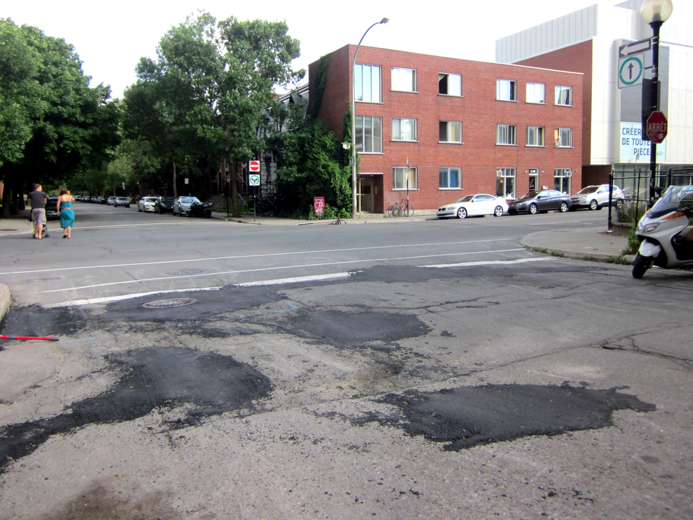 Riding in Montréal can be bumpy. Canada's harsh winters take a toll on the streets. Road repair is always on the agenda for Vélo Québec.