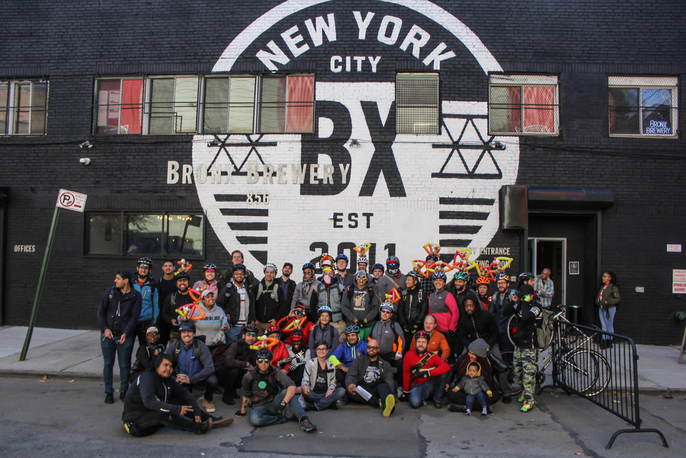 Group photo of the riders, organizers, and volunteers at the Bronx Brewery.