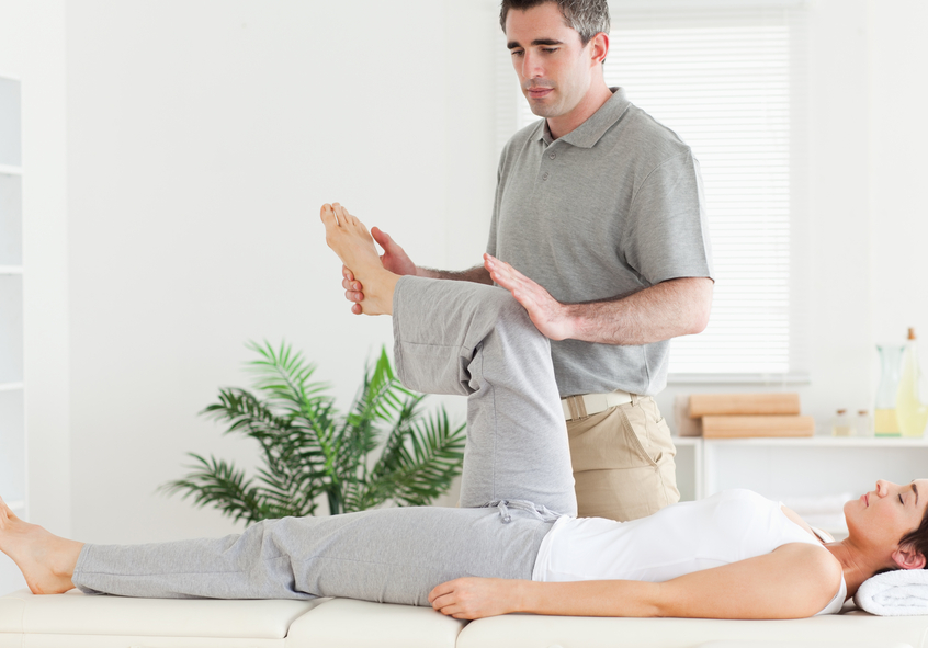 depositphotos_11189594-Chiropractor-stretching-a-customers-leg.jpg