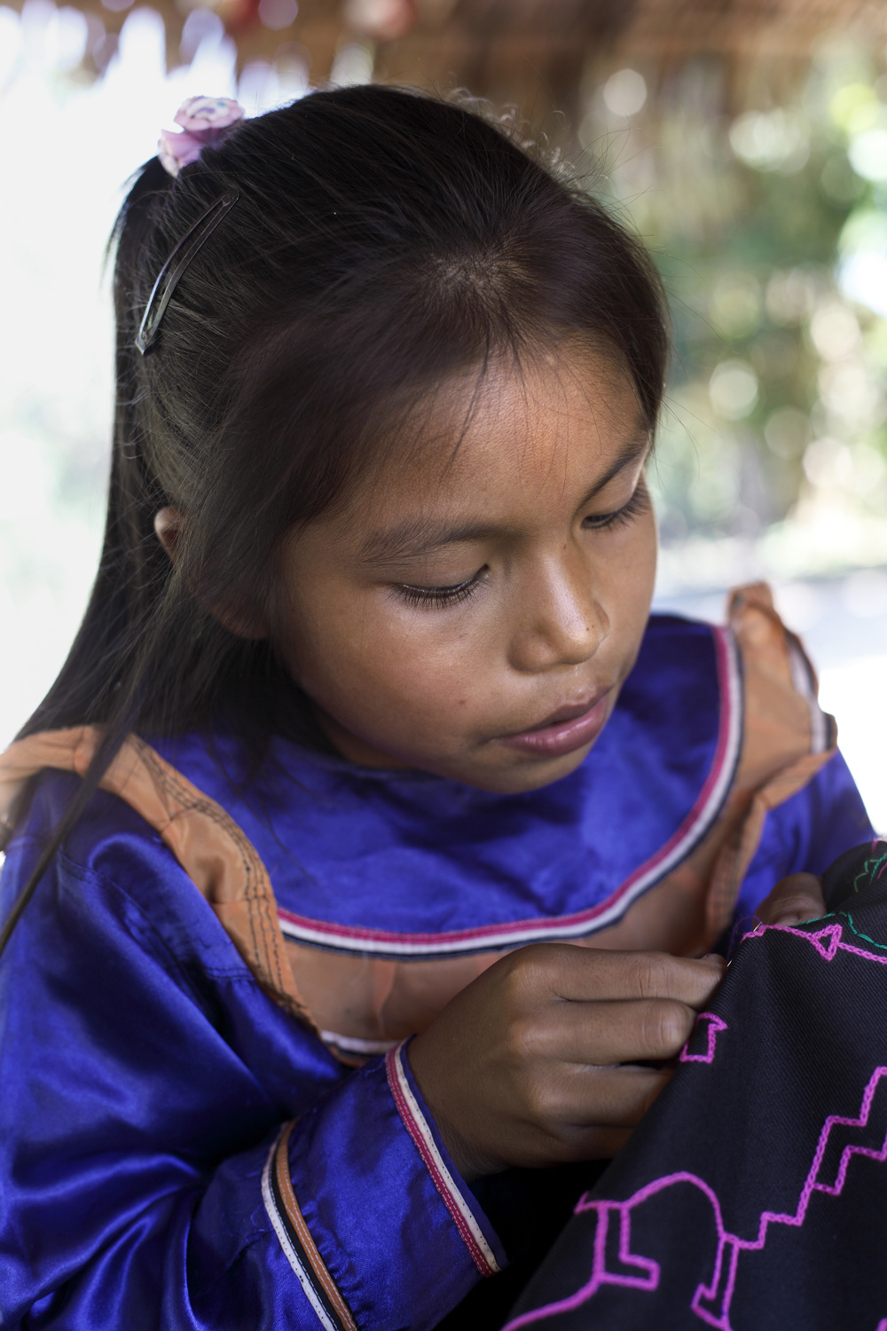 Shipibo girl embroiders 'kene'', meaning 'designs'. Traditionally inspired by visionary experiences of the patterns of plant spirits seen in healing ceremonies (Photo Alianza Arkana)