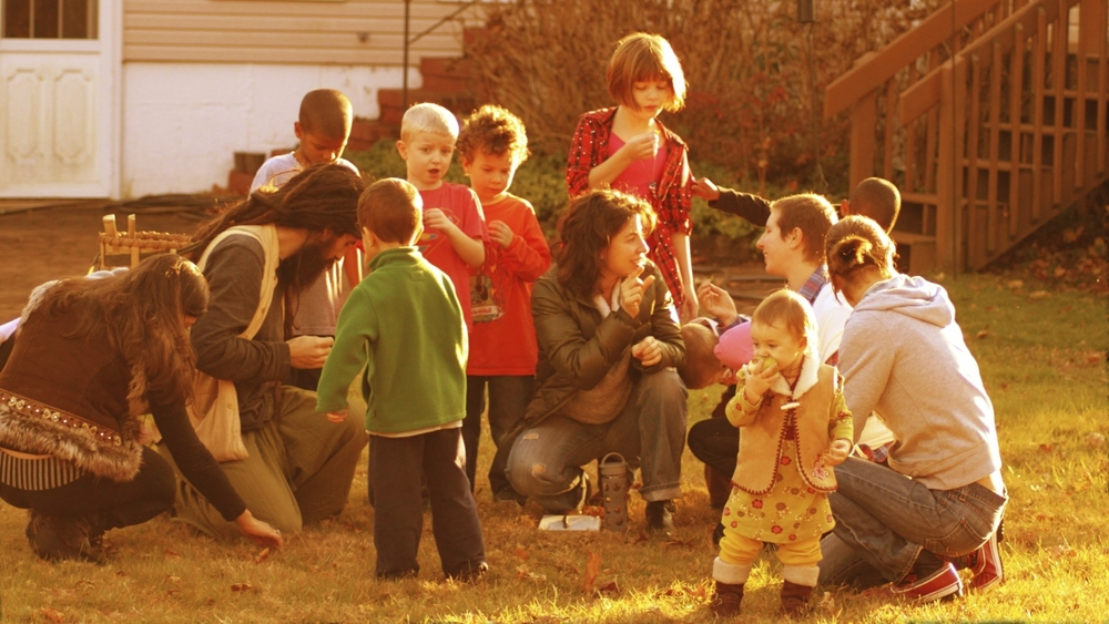 Kids interacting in outdoor education to learn about nature