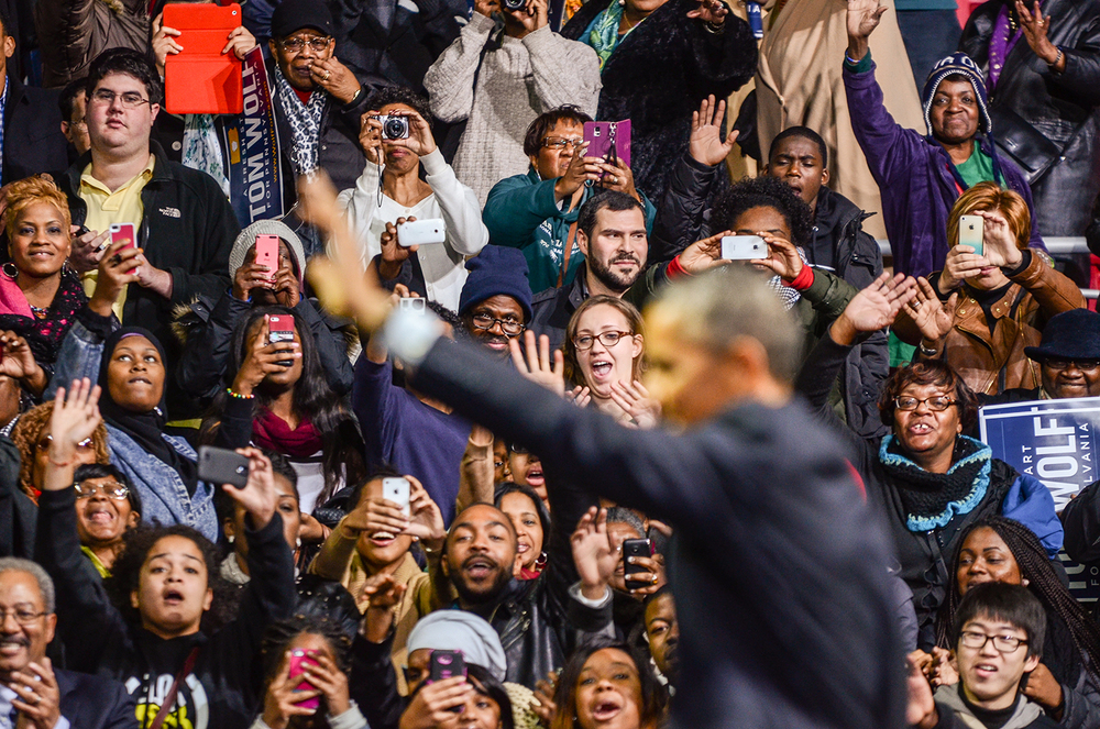 President Barack Obama waves to prospective voters at a rally for Tom Wolf at the Liacouras Center on Nov. 2.