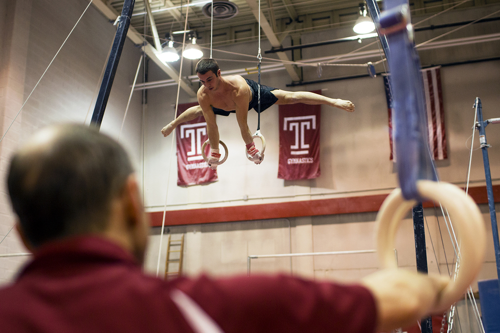 Longtime men's gymnastics coach Fred Turoff watches sophomore Casey Polizzotto practice on the rings in McGonigle Hall on Jan. 26.