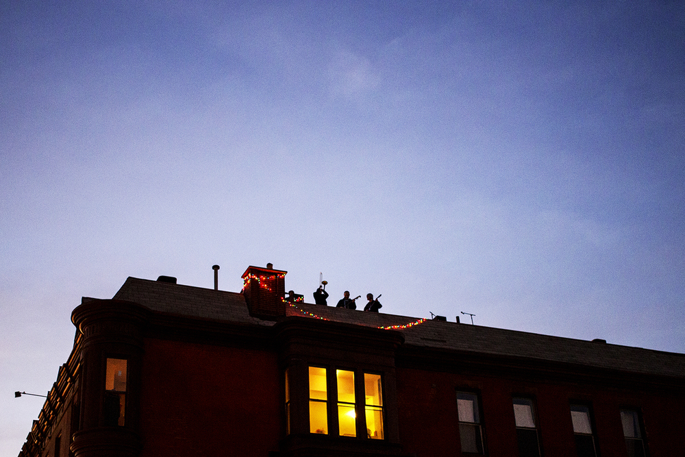 Students and musicians gather Nov. 9 on the rootop of a building on Diamond and Carlisle streets for a music festival.