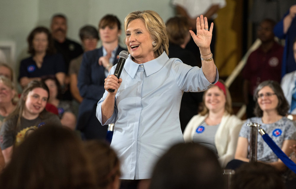 Hillary Clinton talks with a crowd of supporters during an organizing meeting at a middle school in Portland, Maine on September 18, 2015.  Clinton took a detour from campaigning in neighboring New Hampshire to make a stop in the city where competitor Bernie Sanders drew large crowds earlier in the month.