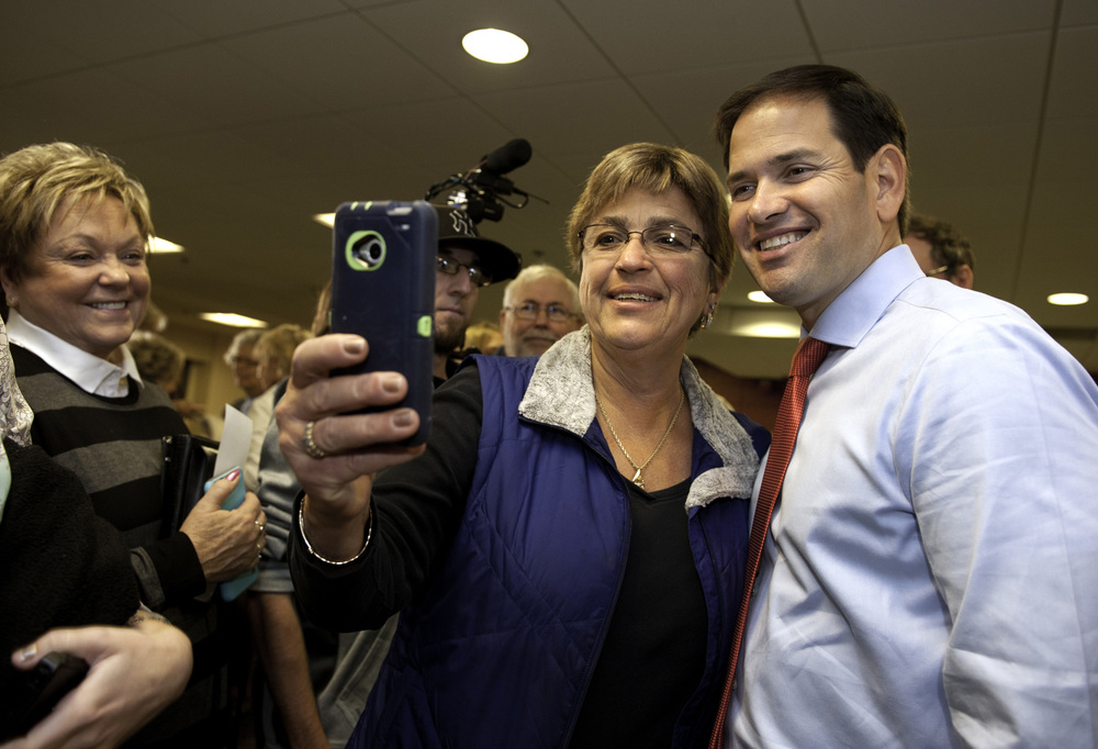 Republican presidential candidate Sen. Marco Rubio greets supporters at a campaign town hall event October 7, 2015 in Dover, New Hampshire. The Florida senator is hoping to attract support in early primary states in the run up to the election.