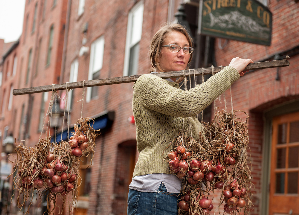 Farmer Martha Putnam of Farm Fresh Connection delivers shallots to hang above diners at Street & Co.  in  Portland, Maine. The restaurant was a pioneer of local dining and sits on a historic brick lane in the city's Old Port Neighborhood. In Portland farm to table dining is not a trend, it's a way of life.