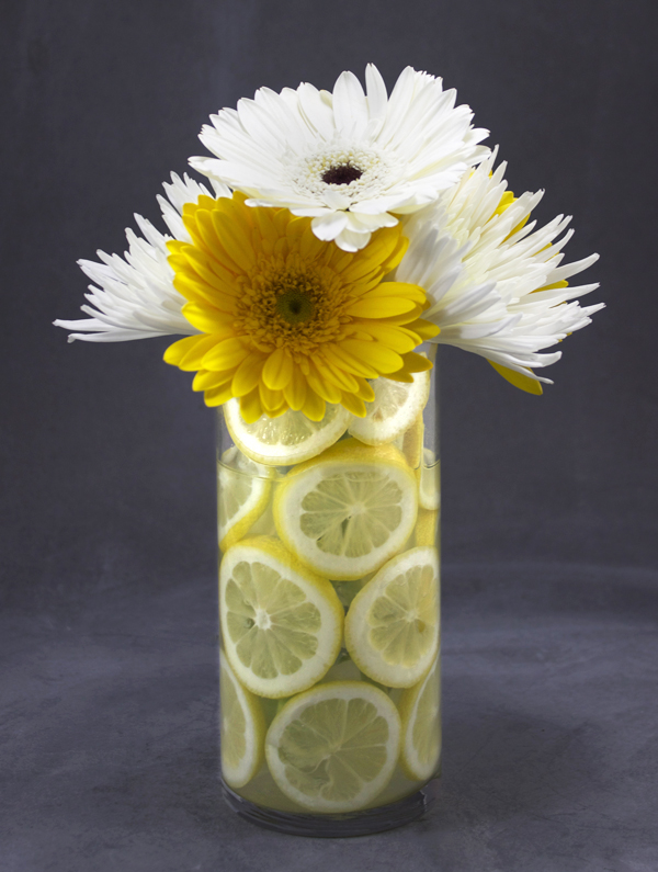 Bridal shower centerpieces with gerbera daisies, spider mums, and lemon slices on Showerbelle.