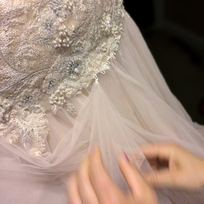 Bridesmaids, do you know how to bustle a wedding gown? Read this super easy tutorial.