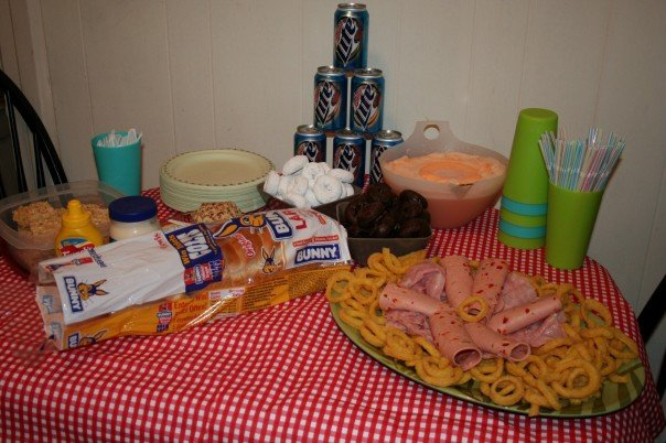 My Tacky Party complete with donettes, a funyun and olive loaf spread, sherbet and ginger ale punch, a Miller Lite tower, and plastic serveware.