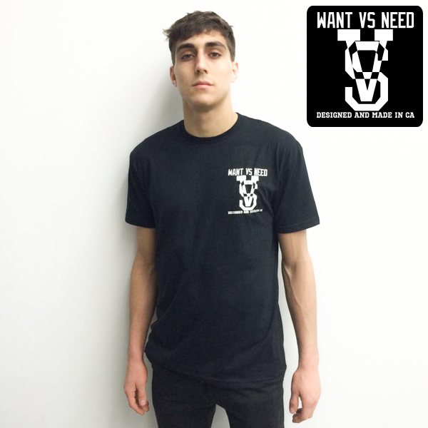 WANT VS NEED POCKET BLACK TEE - DESIGNED AND MADE IN CA - SIMPLE AND CLEAN.