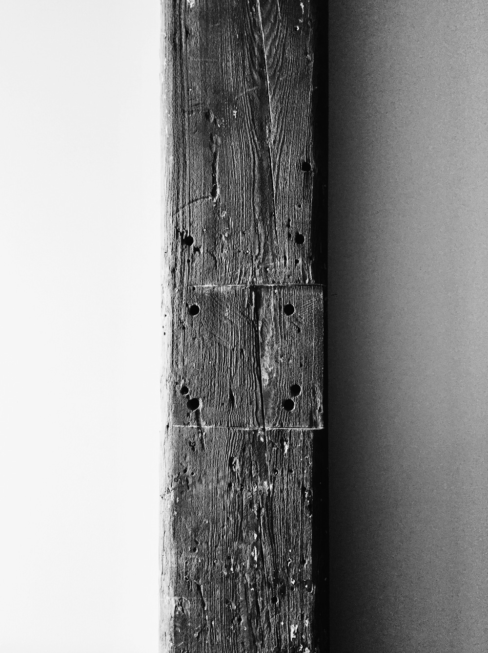 Wooden beamsthat run throughout the floors and ceilings of the Wythe Hotel.
