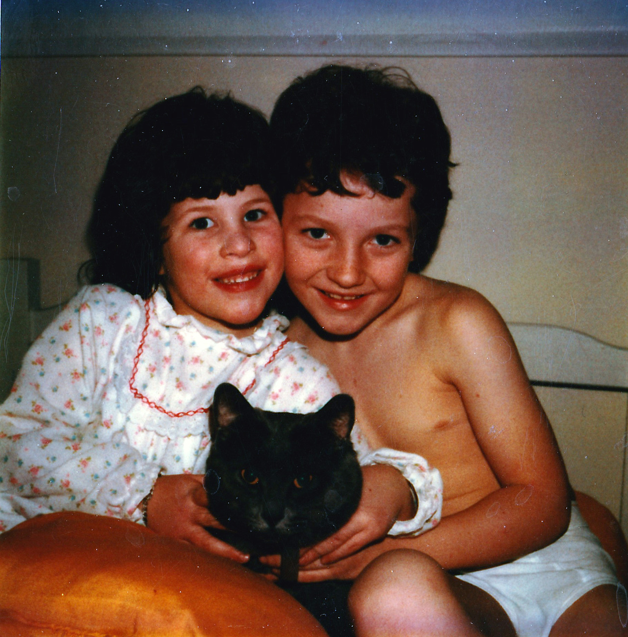 Me at about 8 years old with my little sister, my cat Shadow, and a rad pair of tighty-whiteys.
