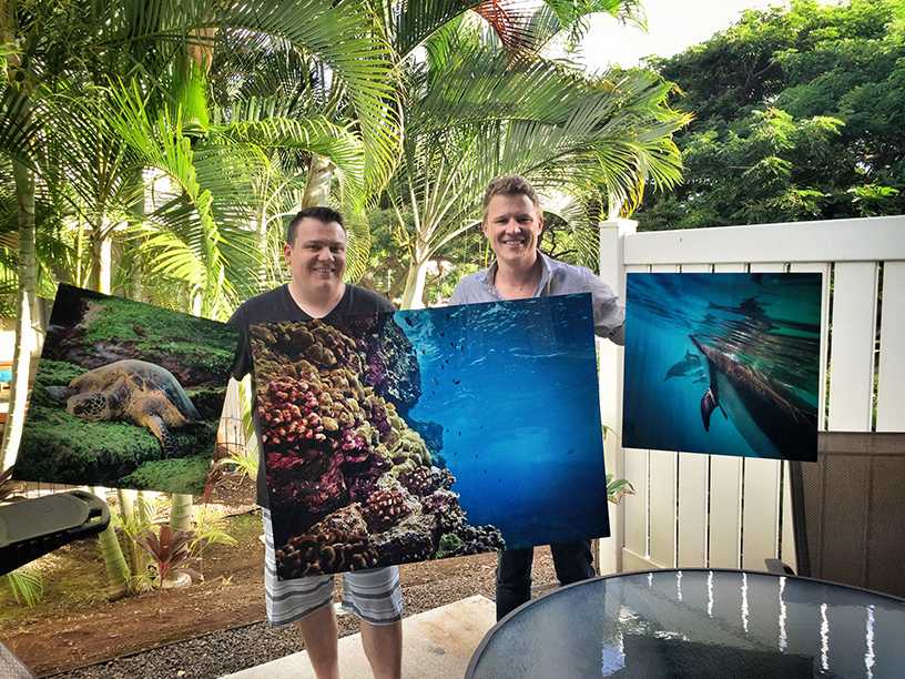 Chris Egan and Michael Hardie hold new aluminum prints.